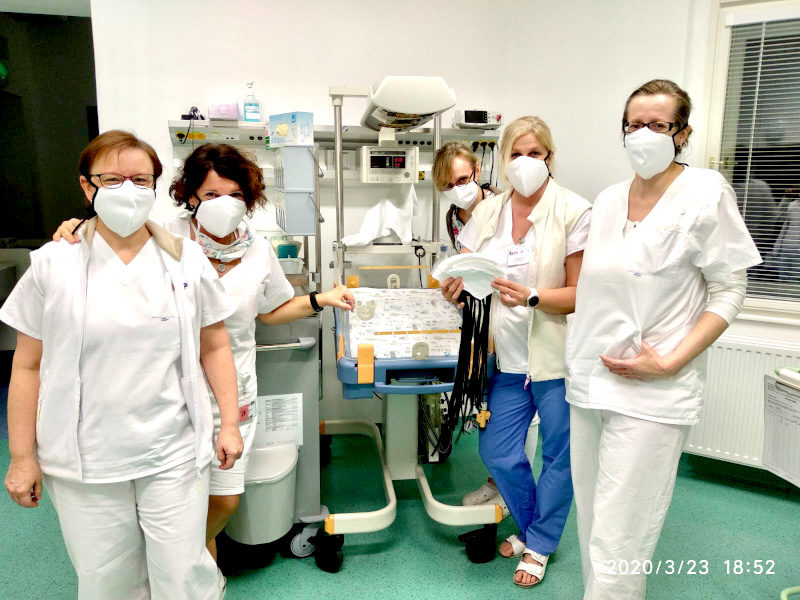 Hospital doctors with protective face masks against coronavirus COVID 19